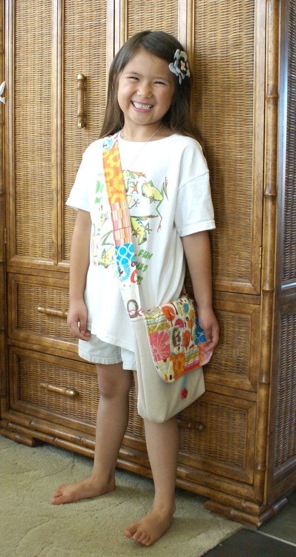 kid with patchwork art bag