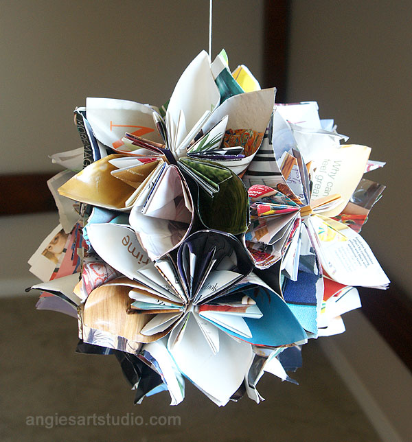 Recycle magazine into flower globe