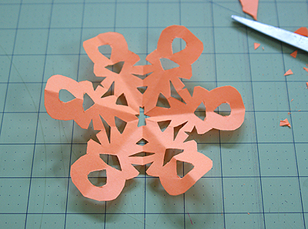 how to make a snowflake with paper and scissors